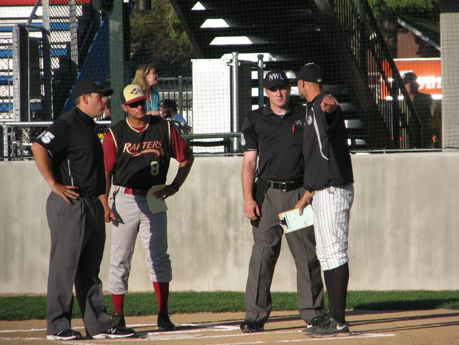 Umpires and managers talk before the game starts
