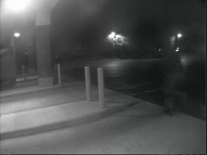 Image of suspect fleeing the Macatawa Bank branch on E. 16th Street in Holland after a robbery on May 30, 2014. (photo courtesy Holland Public Safety)