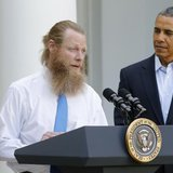 U.S. President Barack Obama watches as Jami Bergdahl (L) and Bob Bergdahl (C) talk about the release of their son, prisoner of war U.S. Army Sergeant Bowe Bergdahl, during a statement in the Rose Garden at the White House in Washington May 31, 2014. Credit: Reuters/Jonathan Ernst