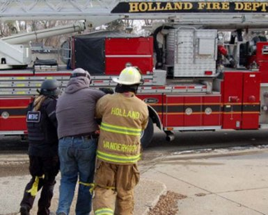 Holland Public Safety firefighters in action (photo courtesy Holland Dept. of Public Safety)