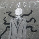 A Slender Man graffitti on the road at Fayetteville Street, Raleigh, North Carolina, by unknown artist. (Photo By mdl70 (http://www.flickr.com/photos/8459320@N03/) [CC-BY-2.0 (http://creativecommons.org/licenses/by/2.0)], via Wikimedia Commons)