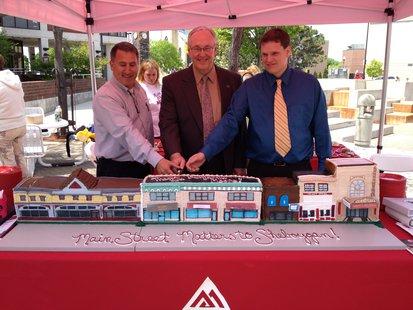 City of Sheboygan officials and a Benjamin Moore representative cut the cake made specially for an event in Sheboygan June 4, 2014.