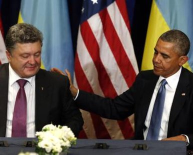 U.S. President Barack Obama meets with Ukraine President-elect Petro Poroshenko in Warsaw June 4, 2014. Obama promised on Tuesday to beef up military support for eastern European members of the NATO alliance who fear they could be next in the firing line after the Kremlin's intervention in Ukraine.  REUTERS/Kevin Lamarque