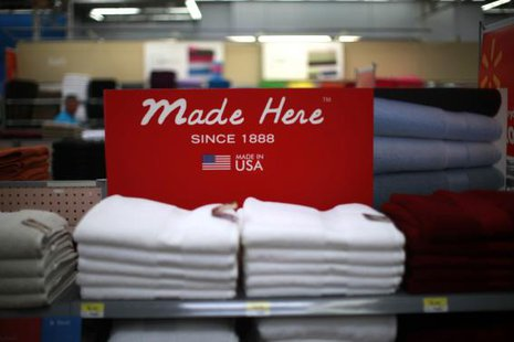A stack of shirts is seen on display at a Walmart Supercenter in Rogers, Arkansas in this June 6, 2013 file photo.  CREDIT: REUTERS/RICK WILKING/FILES