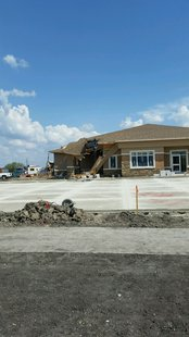 Crane tips on funeral home building under construction in West Fargo