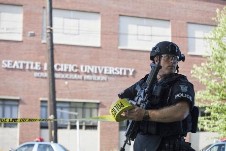 A policeman secures the scene at Seattle Pacific University after the campus was evacuated due to a shooting in Seattle, Washington June 5, 2014.