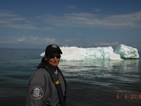 Marine Warden Amie Egstad with a Lake Superior iceberg in the background  Photo: Wisconsin DNR