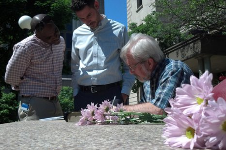 Michael Vinson, left, and Todd Kane, middle, both of Green Bay, sign marriage papers outside the Brown County Courthouse June 9, 2014. The two became the first male same-sex couple to marry in Brown County. (Photo from: FOX 11).