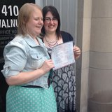 Natalie, left, and Heather Starr pose in front of the Outagamie County Administration Building in Appleton with their marriage license June 9, 2014. The Starrs were the first same-sex couple to be legally married in Outagamie County. (Photo from: FOX 11.)
