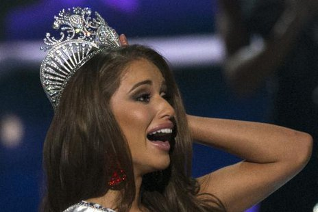 Miss Nevada Nia Sanchez reacts after winning the 2014 Miss USA beauty pageant in Baton Rouge, Louisiana June 8, 2014. REUTERS