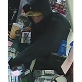Surveillance image from the June 2, 2014, armed robbery of the U-Pump Citgo, 1233 Velp Ave. (Photo from: Green Bay Police Department).