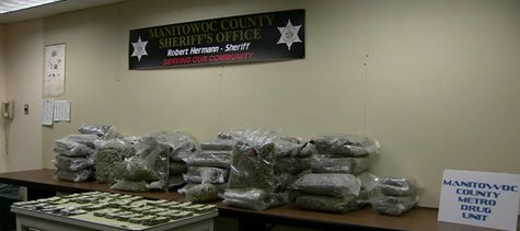 Manitowoc County Metro Drug Unit unveils seizures during weekend drug bust. (Photo from: FOX 11/YouTube).