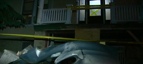 A car is driven into an apartment building in Fond du Lac on Tuesday June 10, 2014. (Photo from: FOX 11/YouTube).