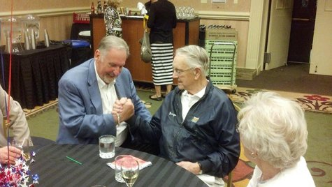 Mayor Walaker, former Governor George Sinner celebrating Walaker's victory.