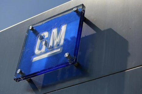 The General Motors logo is seen outside its headquarters at the Renaissance Center in Detroit, Michigan in this file photograph taken August 25, 2009. CREDIT: REUTERS/JEFF KOWALSKY/FILES