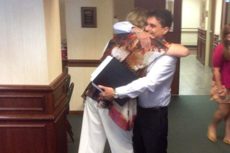 Jackie Pische hugs Ben Adler at Theda Clark Medical Center in Neenah, June 11, 2014. Adler received a heart transplanted from Pische's son, Joshua Richards, who was shot and killed at Luna Lounge in Appleton, Dec. 8, 2013. (Photo from: FOX 11).