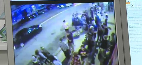 Green Bay Police reviewing video of a downtown disturbance outside several bars on June 7, 2014. (Photo from: FOX 11/YouTube).