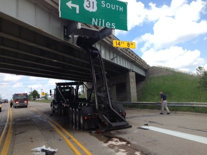 Scene of where a truck's hydraulic lift damaged a bridge carrying US-31 southbound traffic over Washington Avenue in Holland, MI on June 10, 2014 (photo courtesy Michigan Department of Transportation)