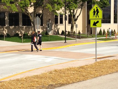 A view of a speed table/raised crosswalk outside the Y.