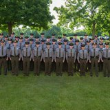 Twenty-three recruits, pictured here with their instructors, successfully completed Michigan Department of Natural Resources conservation officer training and graduated June 13, 2014. Photo provided by Michigan DNR.