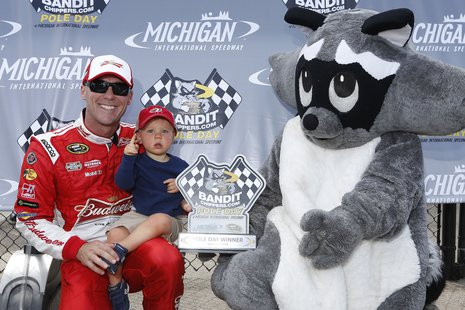 NASCAR Sprint Cup Series driver Kevin Harvick celebrates his 204.557 mph winning pole speed at Michigan International Speedway on June 13, 2014, with his son Keelan and the Bandit Chippers bandit. Photo by: LAT USA.