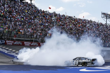 Jimmie Johnson performs his post-race burnout after winning the NASCAR Quicken Loans 400 at Michigan International Speedway June 15, 2014