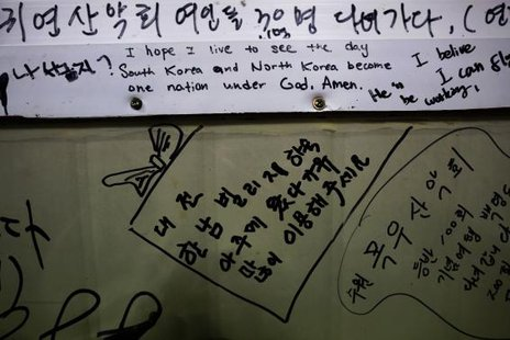 A pro-unification message is seen on a wall in a small fisherman's restaurant on the island of Baengnyeong, which lies on the South Korean side of the Northern Limit Line (NLL), in the Yellow Sea in More... CREDIT: REUTERS/DAMIR SAGOLJ/FILES