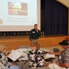 A Michigan Department of Natural Resources official presents information at a Coldwater Lake State Park meeting at Coldwater High School, June 17, 2014