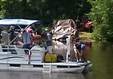Law enforcement dive team members and a tow truck operator recover Mattheau Chaignot's vehicle from the Eau Claire River 6/17/14.  Photo: WSAU
