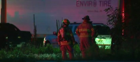 Firefighters in Green Bay respond to fire at a tire business on Wednesday June 18, 2014. (Photo from: FOX 11/YouTube).