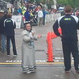Grandma cheering on the finishers of the 1/2 Marathon