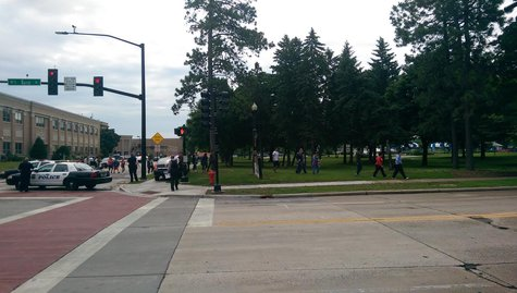 Students are being moved out of Green Bay East High School following a report of a gun inside the school on Monday June 23, 2014. (Copyright Midwest Communications, Inc.)