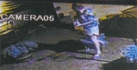 This surveillance image released June 23, 2014, by Menasha police shows the suspect in several recent thefts of fuse blocks for central air conditioning units. (Photo from: Menasha Police Department).