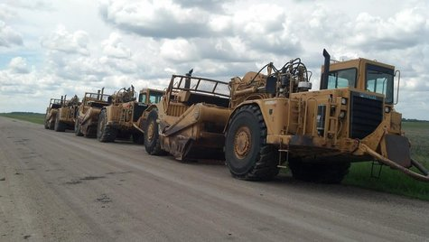 Heavy equipment staged for Oxbow ring dike