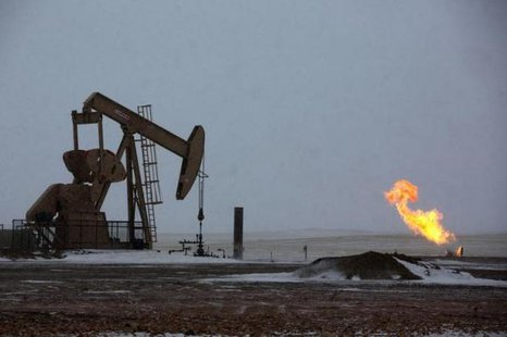 Natural gas flares are seen at an oil pump site outside of Williston, North Dakota March 11, 2013. CREDIT: REUTERS/SHANNON STAPLETON