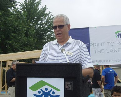 Lakeshore Habitat for Humanity Executive Director Jack Zandstra speaks before a project on 24th Street in Holland on June 25, 2014.