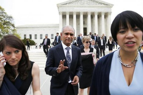 Aereo CEO and founder Chet Kanojia (C) departs the U.S. Supreme Court in Washington April 22, 2014. CREDIT: REUTERS/JONATHAN ERNST