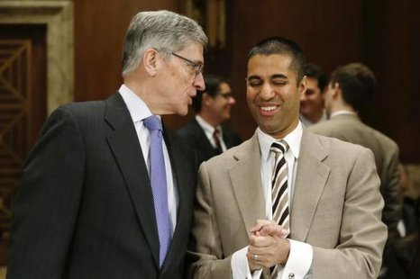 Federal Communications Commission (FCC) Chairman Tom Wheeler and FCC Commissioner Ajit Pai arrive to testify before a Senate Appropriations Financial Services and General Government Subcommittee hearing on the FY2015 budget justification for the FCC, on Capitol Hill in Washington March 27, 2014. CREDIT: REUTERS/JONATHAN ERNST