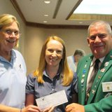 Becky Royer (Coldwater) Michigan State Auxiliary President and Jeff Hull (Williamston) Michigan State Aerie President presenting a check to Amy Duff, executive director of the Branch County Commission on Aging/Burnside Center accepting a check for $2,500 for a new medical transport van for seniors.
