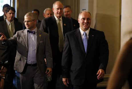 House Majority Whip candidate Steve Scalise (R) arrives with Rep. Patrick McHenry (L) for House Republican leadership elections in the Longworth House Office Building on Capitol Hill in Washington, June 19, 2014. CREDIT: REUTERS/JIM BOURG