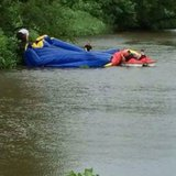 Bounce house winds up in the Park River in Grafton