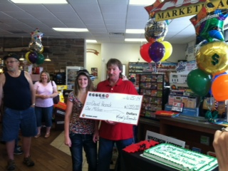 Dave Resnick and daugher accept check