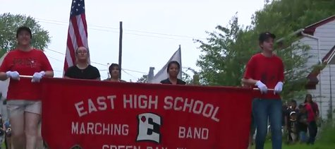 Green Bay East High School's marching band prepares for National Independence Day parade in Washington D.C. (Photo from: FOX 11/YouTube).