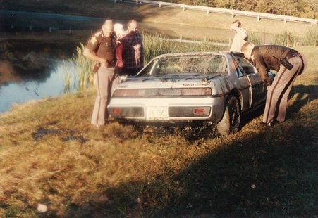 Mindy's Fiero being examined by Vigo County Sheriff's Deputies
