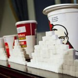 A 64-ounce drink is displayed alongside other soft drink cup sizes at a news conference at City Hall in New York, May 31, 2012. CREDIT: REUTERS/ANDREW BURTON