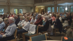 Neighbors pack a meeting to air concerns and learn more about a planned homeless development in Moorhead