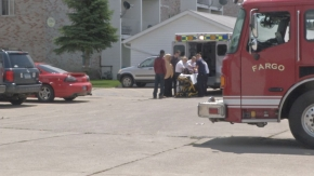 Medical personnel attending to a boy who fell off a 2nd floor balcony in south Fargo