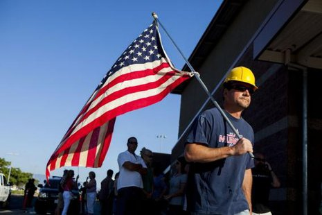 Murrieta resident Paul Hathaway, who is opposed to undocumented immigrant being brought to the city, heads into a town hall meeting to discuss the processing of undocumented immigrants in Murrieta, More... CREDIT: REUTERS/SAM HIDGSON