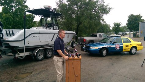"Mike Panosh with the Wisconsin State Patrol's Bureau of Transportation Safety talking about ""Where the Rudder Meets the Road"" initiative in Oshkosh on July 2, 2014. (Copyright Midwest Communications, Inc.)"