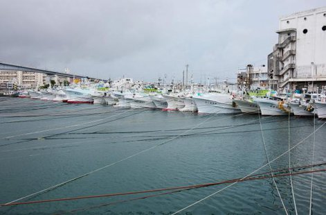 Fishing boats are moored at Tomari port in Naha on Japan's southern island of Okinawa as super typhoon Neoguri approaches the region, in this photo taken by Kyodo July 7, 2014. CREDIT: REUTERS/KYODO
